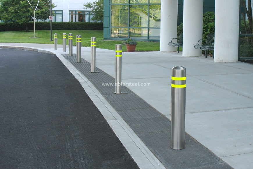 Stainless steel bollard covers with reflective strips outside a hospital